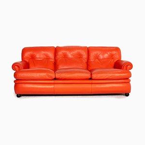 Poltrona Frau Dream en sofá de cuero coral