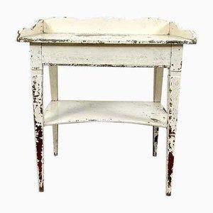 Mesa auxiliar francesa antigua pintada de blanco