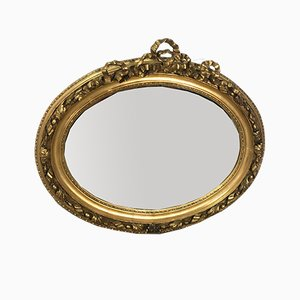 Specchio Luigi XVI ovale in legno e stucco dorato