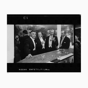 New Year at Romanoff's Silver Gelatin Fiber Print Framed in Black by Slim Aarons