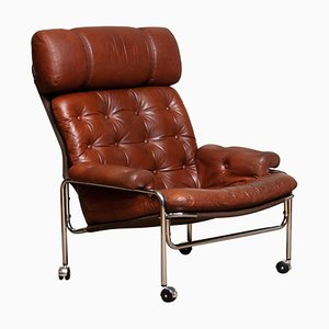 Easy Chair in Chrome and Aged Cognac Leather by Lindlöfs, 1960s