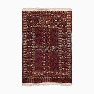Antiker turkmenischer burgunderfarbener Teppich