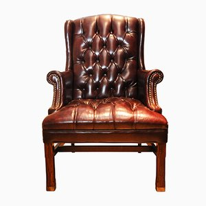 George III Deep Buttoned Oxblood Leather Wingback Chesterfield Armchair with Brass Details