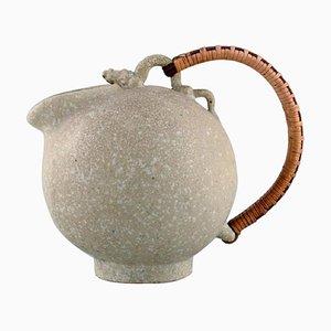 Brocca in ceramica smaltata con manico in vimini di Arne Bang