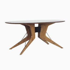 Italian Sculptural Oval Dining Table with Black Glass Top, 1950s