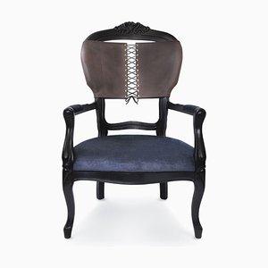 Poltrona con schienale in pelle marrone e seduta in velluto color carbone di Mineheart
