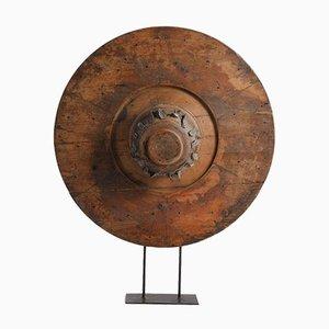 Holzrad auf Eisenfuß