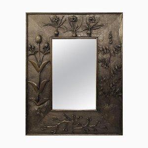 Specchio con cornice in legno massello di motivi vegetali incisi