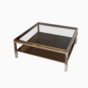 Mesa de centro de latón dorado y metal cromado, años 70