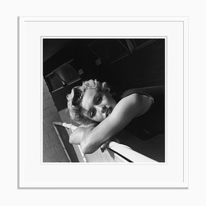 Far Away Look Silver Gelatin Resin Print Framed in White by Hulton Archive