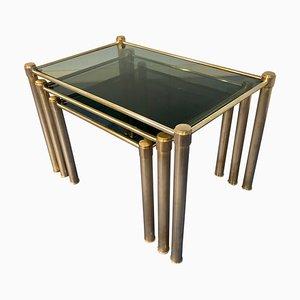 Tavolini a incastro Mid-Century moderni in ottone e vetro fumé, Italia, anni '70, set di 3