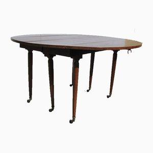 Runder Tisch mit 6 spindelförmigen Beinen und Verlängerung aus Mahagoni