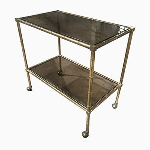 Mid-Century Modern French Gilt Metal & Faux Bamboo Bar Cart with Smoked Glasses by Maison Baguès, 1960s