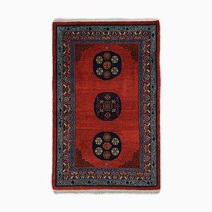 Geometrischer tibetanischer Teppich in Dunkelrot mit Border und Medaillon