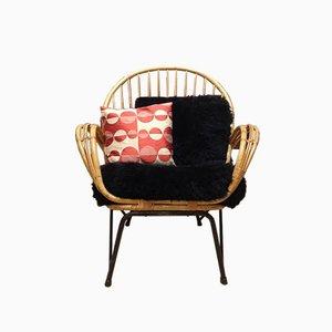 Silla danesa de bambú con cojines de piel de oveja negra, años 50
