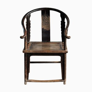 Horseshoe Armchair with Bat Carving