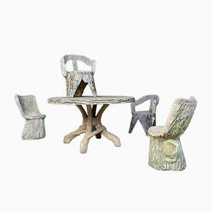 Juego de muebles de jardín de concreto con efecto tronco