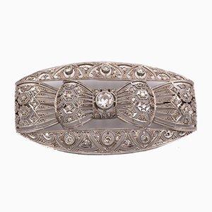 Broche Art Decò en platino con brillantes diamantes tallados, años 30