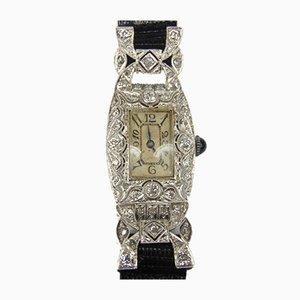 Reloj de noche Art Déco de oro blanco con diamantes talla brillante y rosetones con movimiento marcado y cabujón de zafiro en la corona de Longines