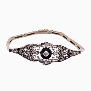 Collar o pulsera modernista en dorado y plateado con diamantes y ónix