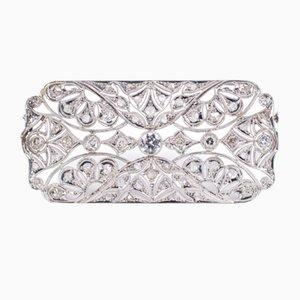 Broche Art Déco antiguo de platino con diamantes tallados y rosetones