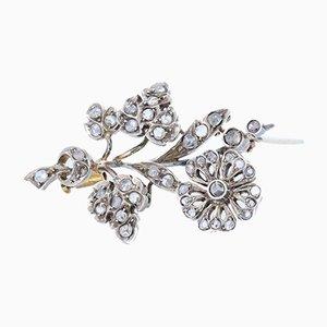 Spilla Liberty in oro 18k e argento con rosette a forma di diamante