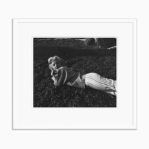 Marilyn Monroe Relaxing on the Grass Silver Gelatin Resin Print Framed in White by Baron