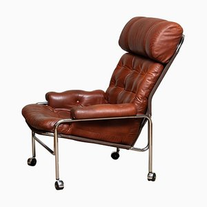 Lounge Chair in Chrome and Aged Brown Cognac Leather from Lindlöfs, 1960s
