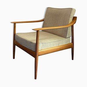 Skandinavischer Armlehnstuhl aus Holz & Stoff, 1960er