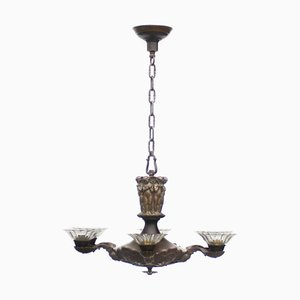 Large Antique Chandelier with Figurative Applications, 1920s