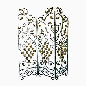 Biombo Art Déco tríptico de hierro forjado con decoración floral de Gilbert Poillerat
