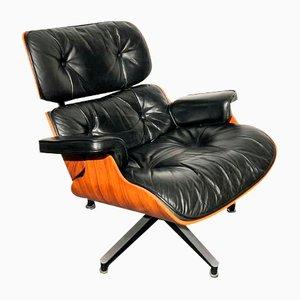 Armlehnstuhl aus Leder von Charles & Ray Eames für Vitra