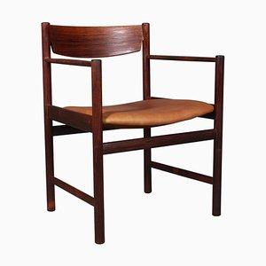 Armchair in Rosewood by IB Kofod-Larsen