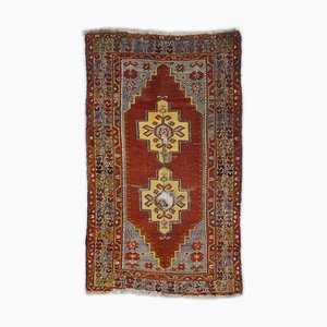 Geometric Kazak Carpet in Rust Red with Border and Medallion