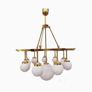 Brass Chandelier with 10 White Globe Lights