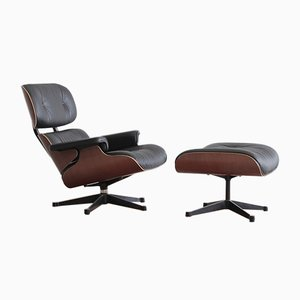 Lounge Chair and Footstool by Charles & Ray Eames for Vitra, 1999, Set of 2
