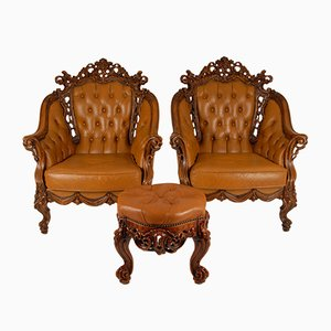 Mid-Century Italian Baroque or Chesterfield Style Carved Walnut & Leather Armchairs and Ottoman, Set of 3