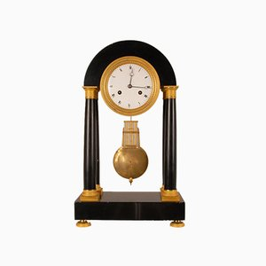 Antique French Directoire Black Marble and Mercury Gilt Column Mantel Clock in Ormolu Bronze, 18th Century