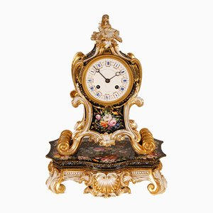 Antique French Rococo Style Porcelain Clock with Foliated Scrolls, Shells and Flowers by Jacob Petit