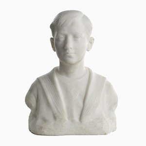 Busto infantil de mármol de Paul Malcouronne