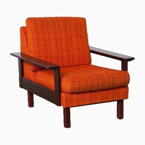Orangefarbener Sessel