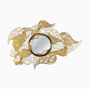 Espejo con rizos dorados