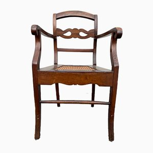 Vintage Armlehnstuhl aus Nussholz & Stroh