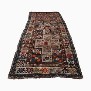 Tappeto geometrico Shirvan marrone scuro con medaglione centrale e bordo