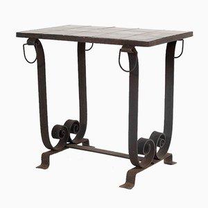 Mesa de recibidor o patio con tablero de azulejos de hierro forjado español