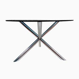 Mesa de comedor de acero cromado con tablero de vidrio tintado
