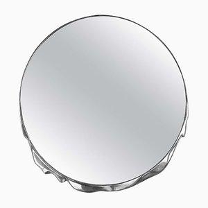 Specchio in metallo liquido