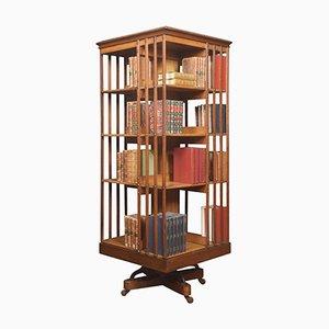 Librería giratoria de nogal y fresno con cuatro niveles