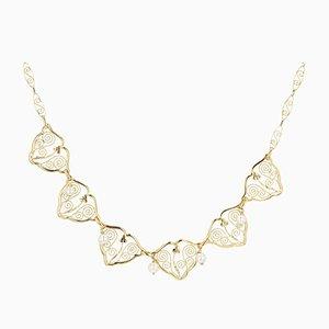 Collar francés de perlas cultivadas y oro amarillo de 18 quilates, siglo XX