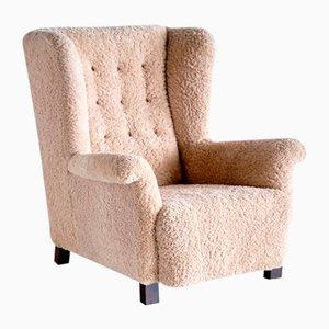 Wingback Chair in Sheepskin by Acton Bjørn for A.J. Iversen, Denmark, 1937
